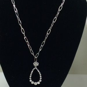 Jewelry - Silvertone with a rhinestone teardrop pendant.